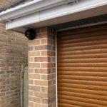 Outdoor security camera next to garage